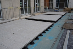 Adjustable paving pedestals line of slabs Athletes Village London