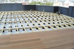 Adjustable decking support for timber decking