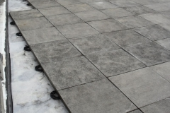 Concrete paving mounted onto paving supports