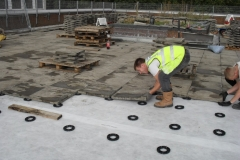 How to lay slabs onto plastic paving pads