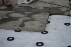 Installation of paving onto pads