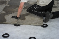 Installing slabs onto paving pads