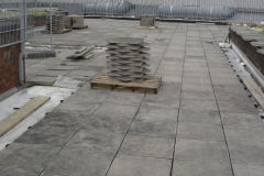 Paving slabs sitting on pave pads