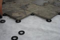 Plastic pave rings under concrete flags