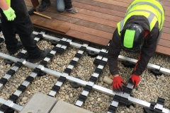 How to build IPE decking on inverted waterproofing 6a adjust height of pads to get rails flat