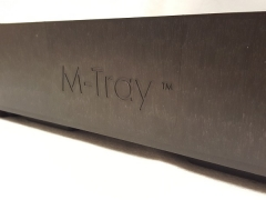 close up of M-Tray logo