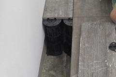 Installing Megapad adjustable paving pedestals to wall