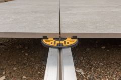 Pedestal Rail System Megapad with rail and headpiece attached and porcelain tile installed