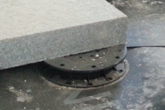 Adjustable Minipad for paving with granite slab close up