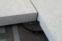Minipad for paving with granite slabclose up