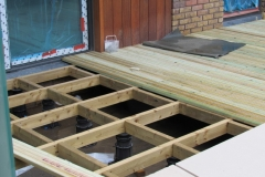 TD Megapad with decking Surrey Quays frame and deck boards part installed