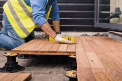 Installing ipe decking tiles on self levelling pads