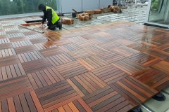 Decking tiles on ballasted inverted waterproofing