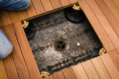 Installing timber decking tiles on pedestals