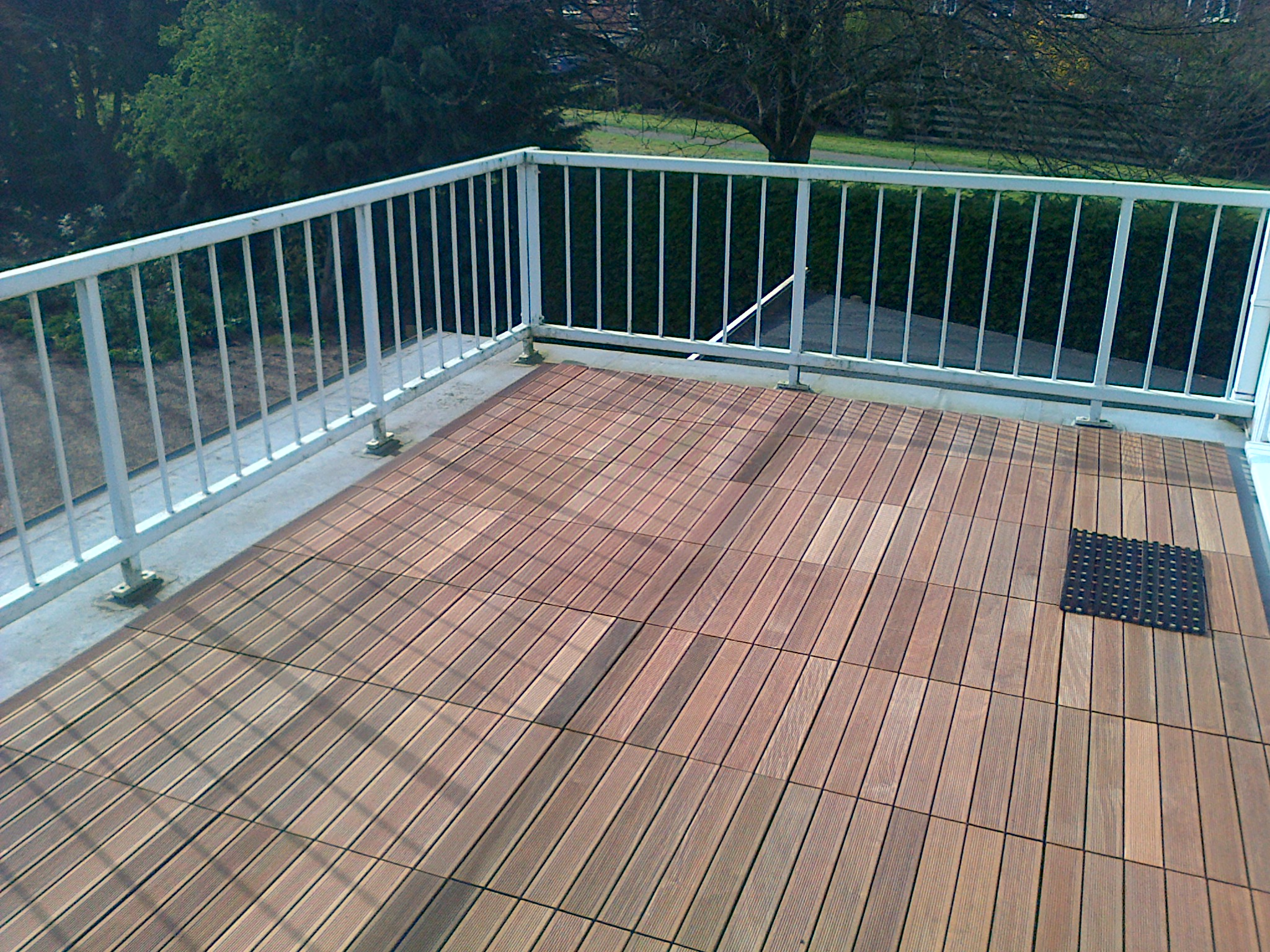 Transform Your Garden With Our Timber Decking Tiles Wallbarn