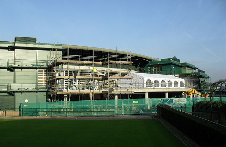 Terraces covered in scaffolding at The All England Lawn Tennis Club in Wimbledon, London