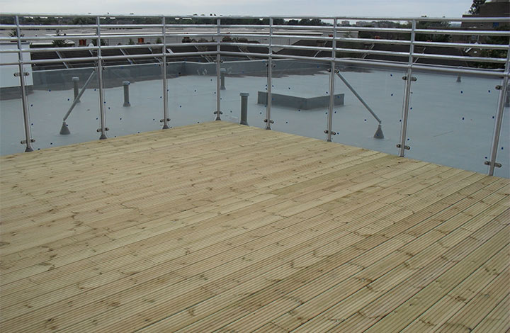 Decking being installed at terrace at oakwood group
