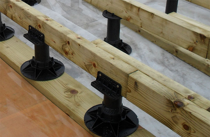 Timber beams over pedestals