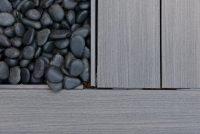 A close up image of oak decking tiles