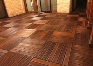 An image of an installation of hardwood decking tiles