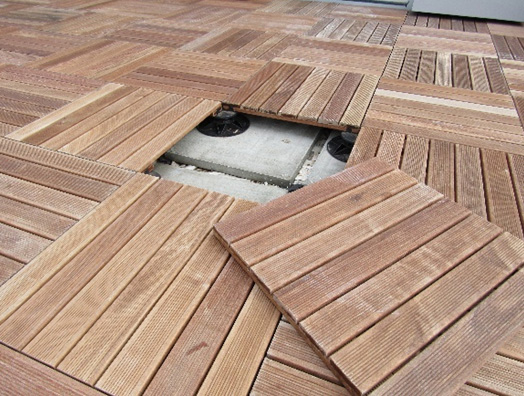An image of a completed timber decking tiles installation