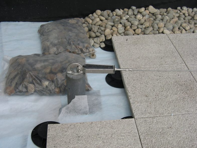 High tenacity geotextile on insulation as part of inverted waterproofing system