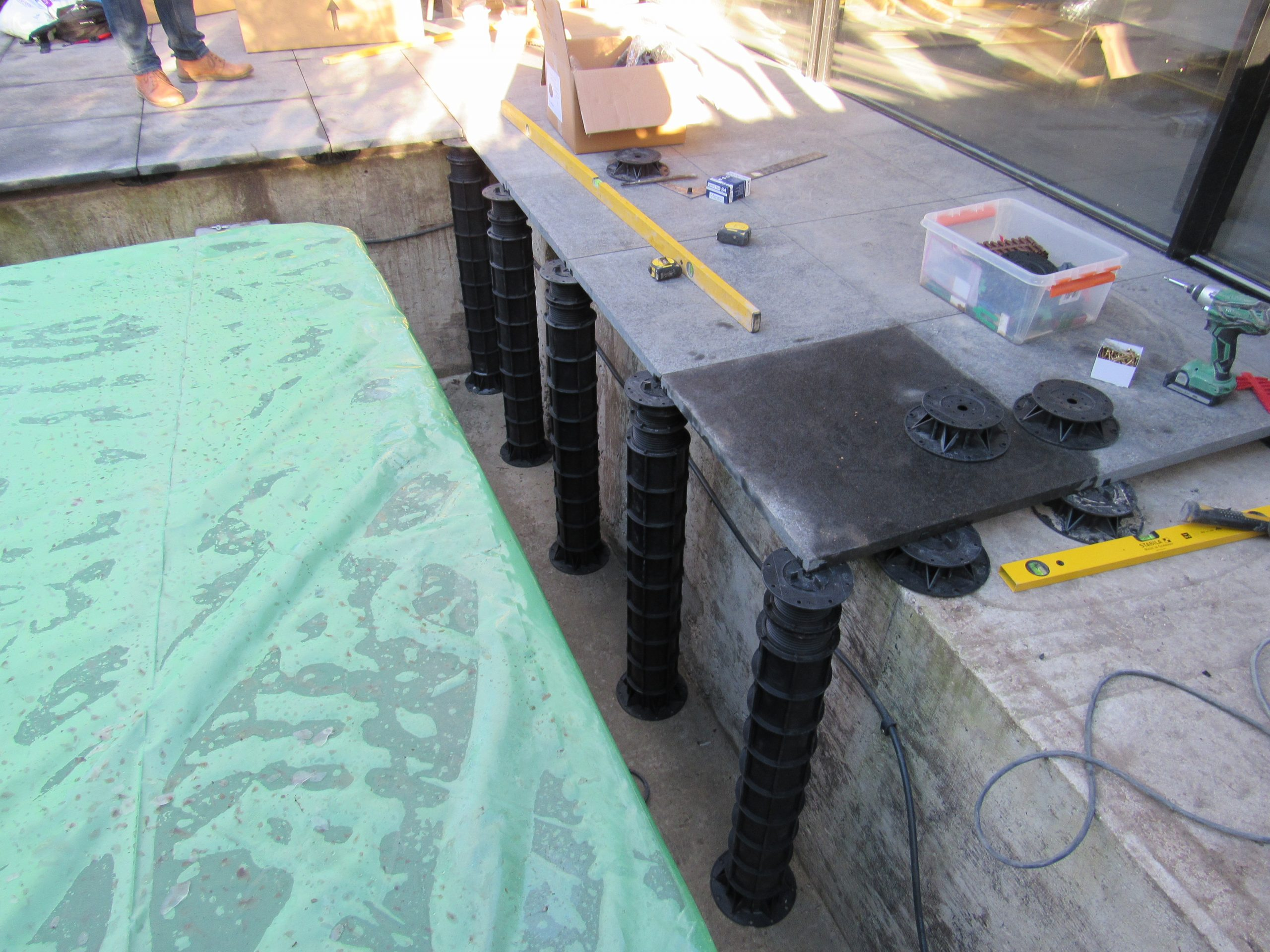 Megapad adjustable pedestals on jacuzzi project