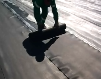 Protecto mat flexible protection layer being rolled out 4