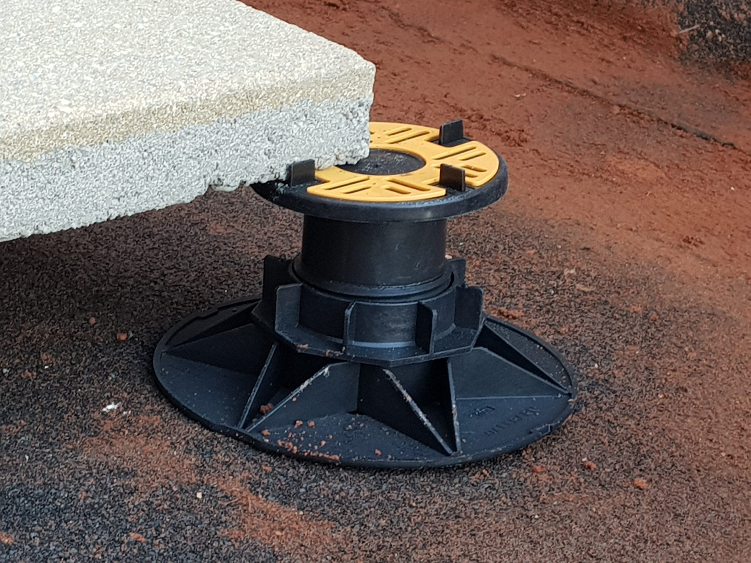 Universal Pedestal for paving and decking - close up with slab 1