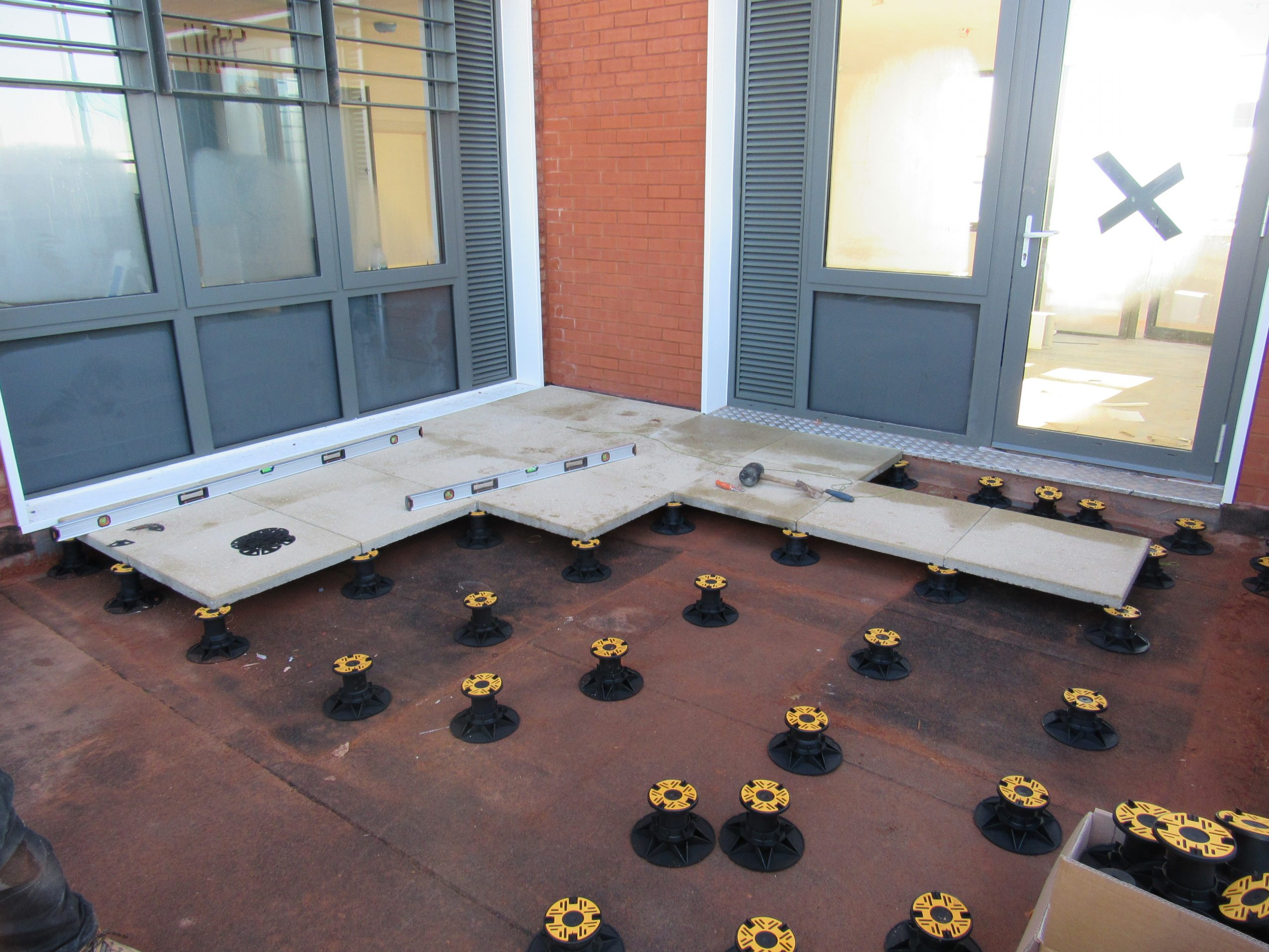 Universal Pedestal for paving and decking laid out for slabs 1