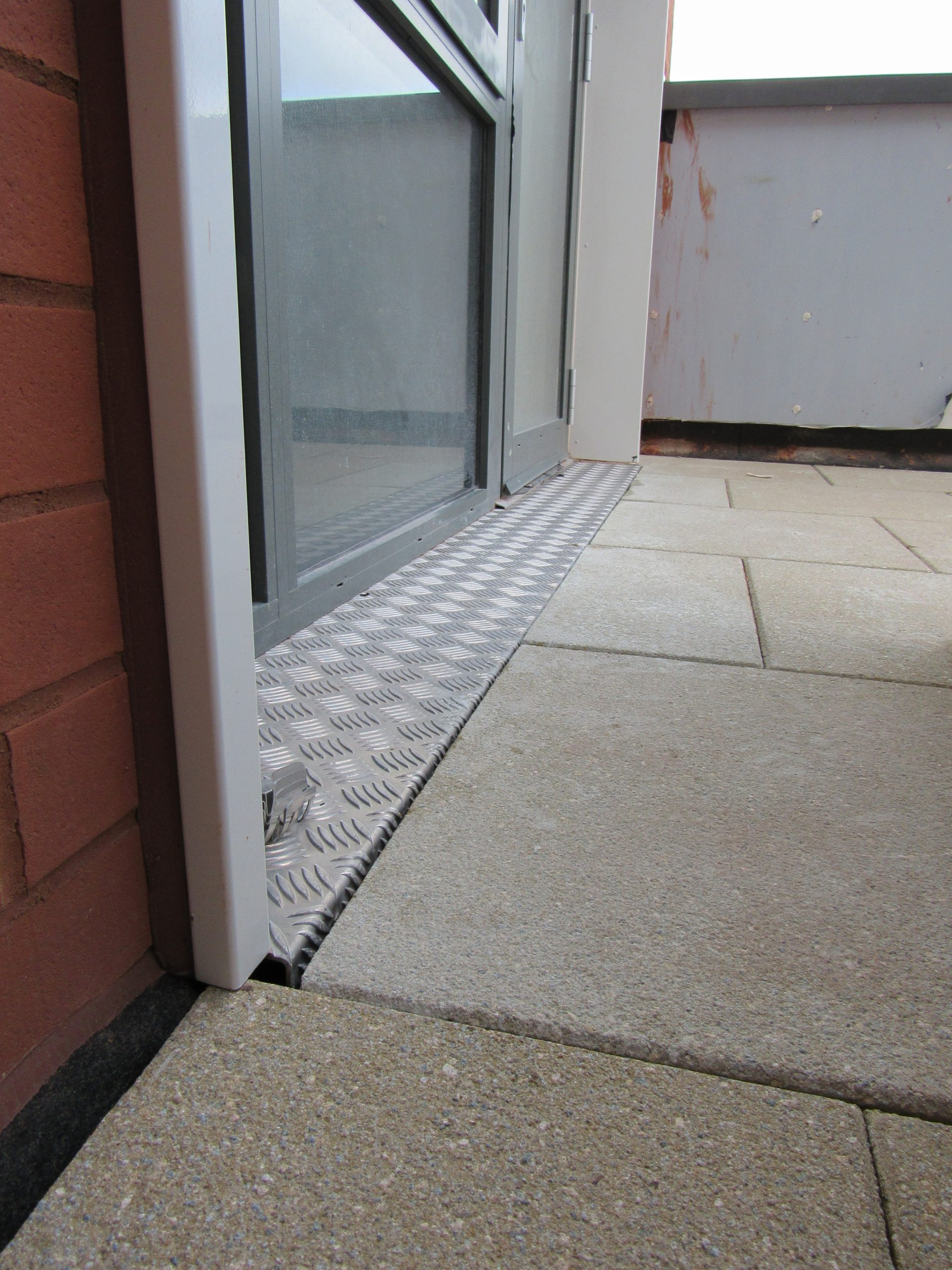 Universal pedestals for paving and decking - paved terrace up to door threshold 4