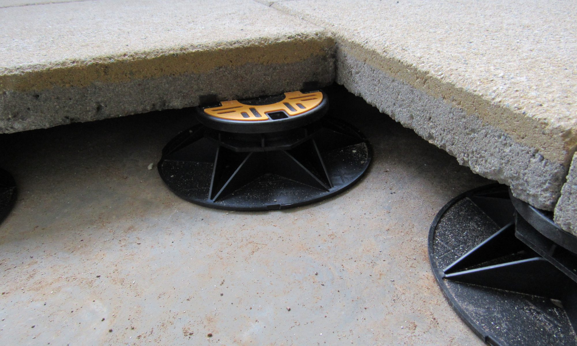 Universal pedestals for paving and decking - supporting paving slab underside 2