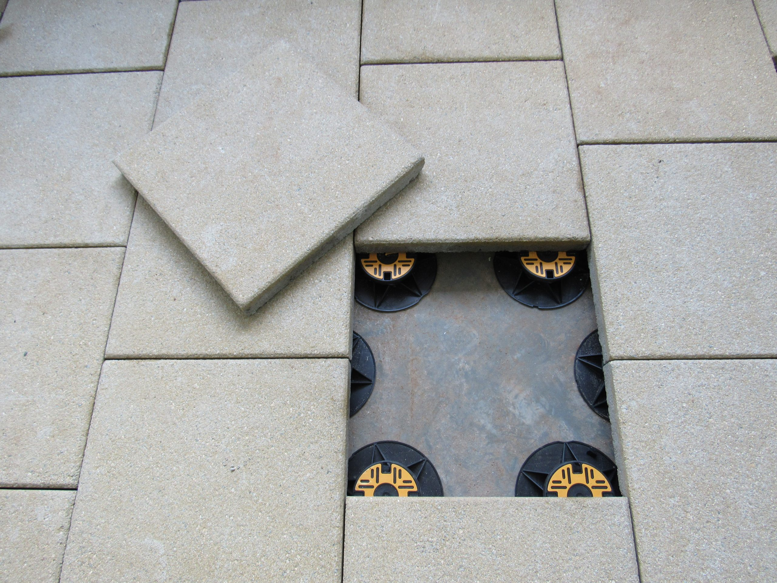 Universal pedestals for paving and decking - supporting paving slabs staggered pattern 1