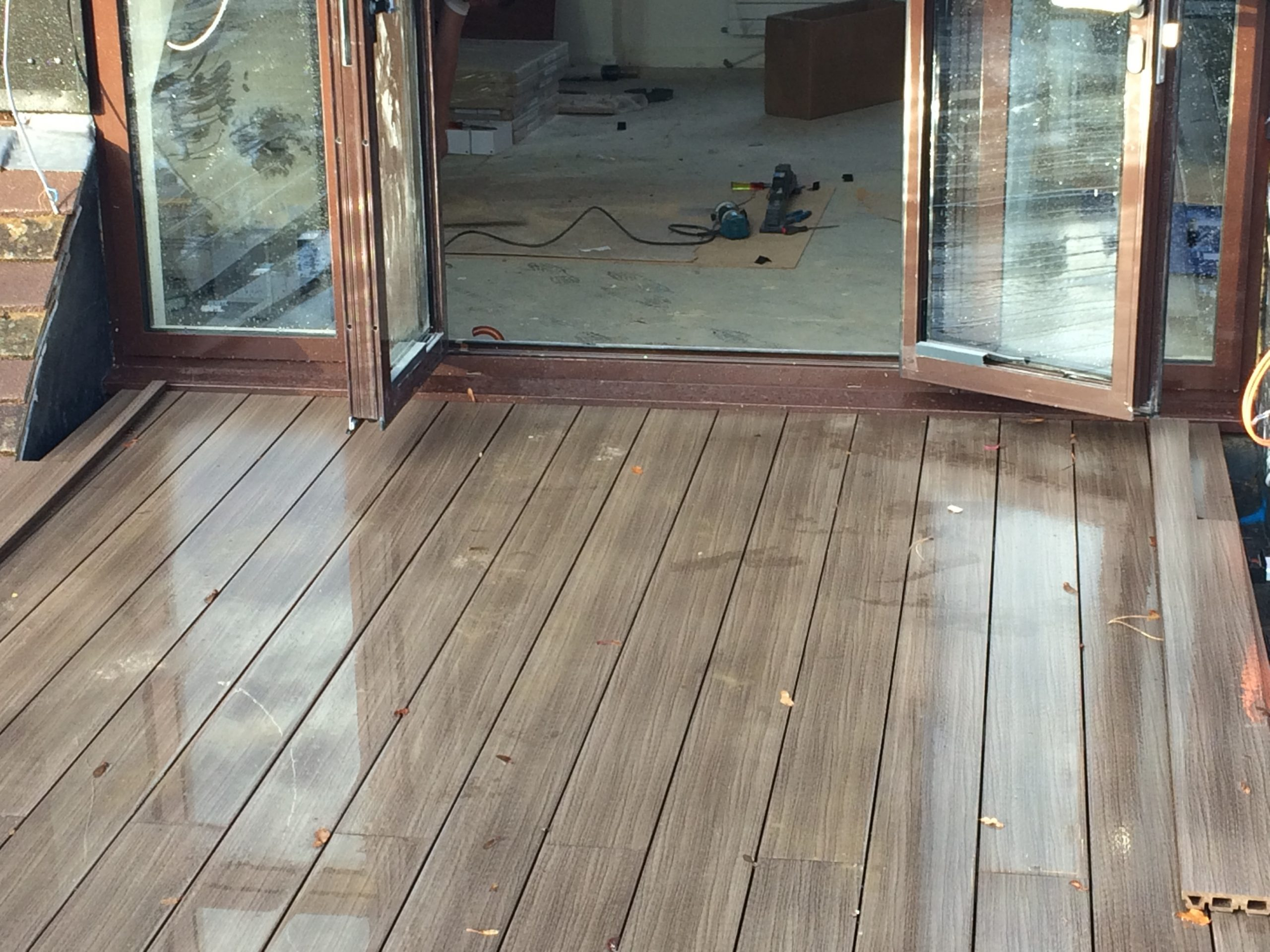 installing Terra composite decking up to doorway 2